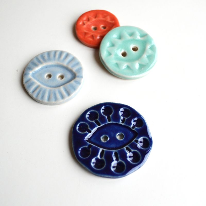 Four_A_Alicia_buttons_on_white